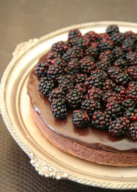 A dark as night choc cake with shiraz glaze and black berries