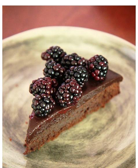 slice dark as night choc cakeshiraz glaze and black berries Cropped IMG_2535 Small
